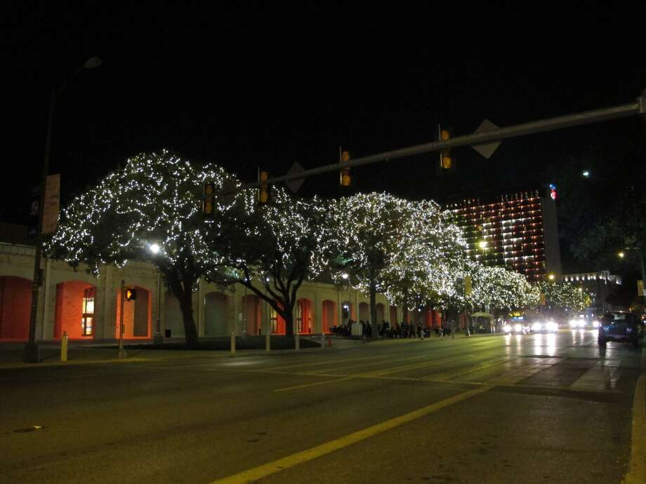 The trees just outside the Convention Center are lit along Market Street.