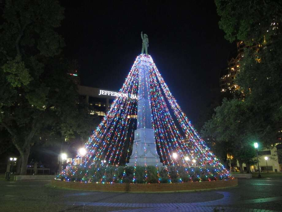 The statue at Travis Park is turned into a Christmas tree.