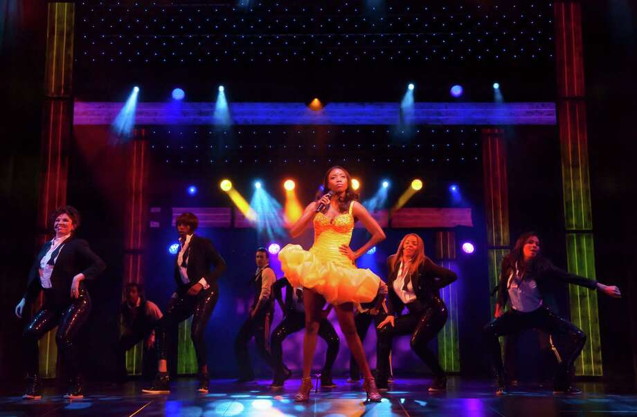 In this undated image made available Thursday Dec. 6, 2012, by the Adelphi Theatre, showing Heather Headley performing in the lead role as Rachel Marron in the new musical stage show The Bodyguard, directed by Thea Sharrock, not pictured, which is due to open at the Adelphi Theatre in London in December 5, 2012.  The stage show is based on the 1992 Bodyguard movie starring Whitney Houston in the lead role. (AP Photo / Paul Coltas, Adelphi Theatre) Photo: Paul Coltas