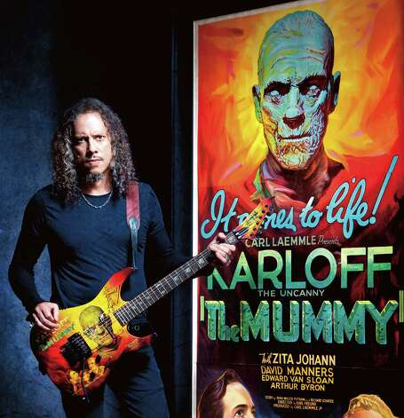 "Metallica guitarist Kirk Hammett shows off a guitar decorated with art from the movie poster for Universal Pictures' ""The Mummy."" Photo: Courtesy, Abrams Image"