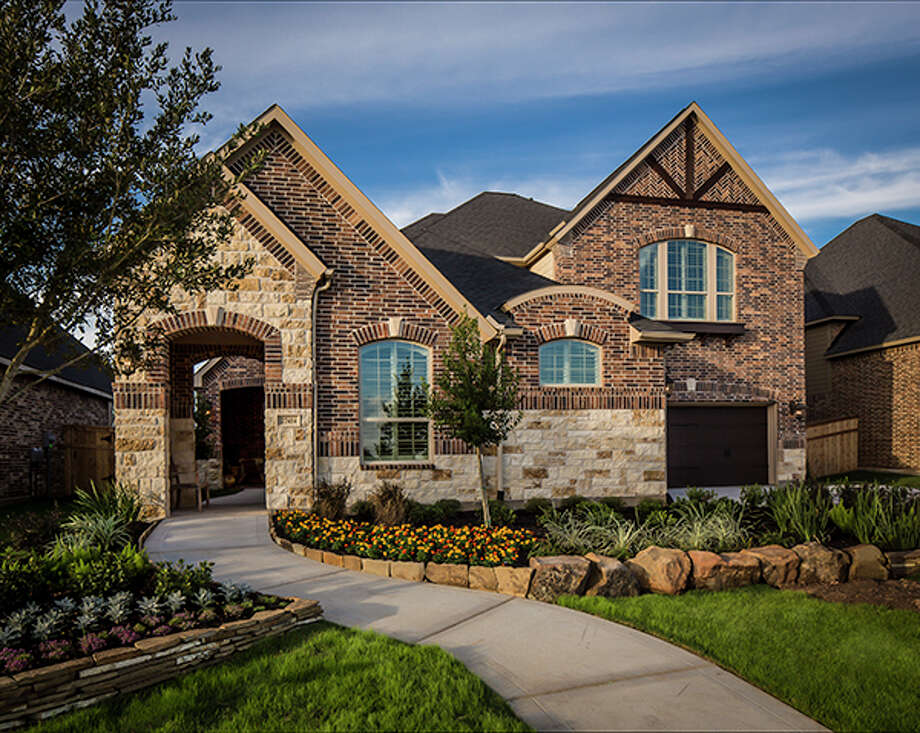 Buyers at Cross Creek Ranch can tour four newly decorated models. Two new patio home models will open in February. Shown is the new C602 Plan with an arched entry leading to a front courtyard.