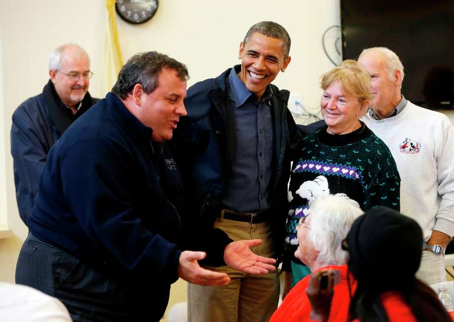 President Barack Obama, center, and Federal Emergency Management (FEMA) administrator Craig Fugate, left, watch as New Jersey Gov. Chris Christie, second from left, meets with local residents at Brigantine Beach Community Center, Wednesday, Oct. 31, 2012, in Brigantine, NJ. Obama traveled to Atlantic Coast to see first-hand the relief efforts after Superstorm Sandy damage the Atlantic Coast. (AP Photo/Pablo Martinez Monsivais) Photo: Pablo Martinez Monsivais, Associated Press / AP