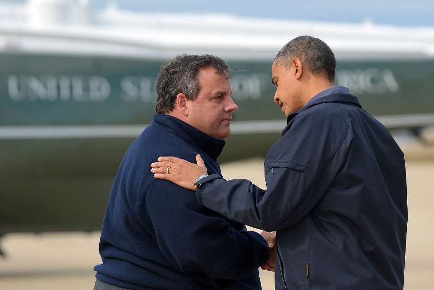 TOPSHOTSUS President Barack Obama (R) is greeted by New Jersey Governor Chris Christie upon arriving