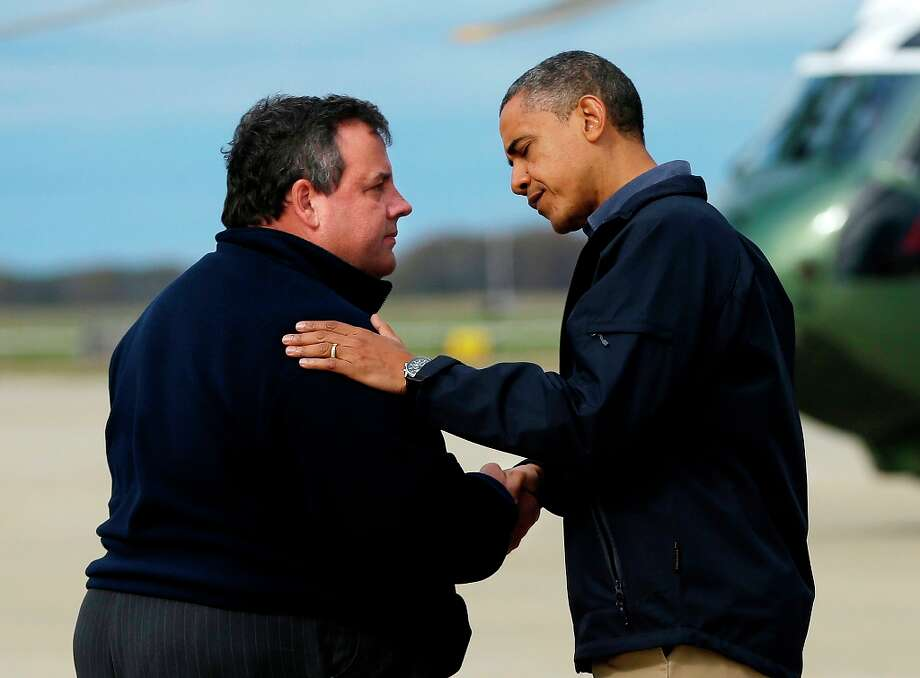 President Barack Obama is greeted by New Jersey Gov. Chris Christie upon his arrival at Atlantic City International Airport, Wednesday, Oct. 31, 2012, in Atlantic City, NJ. Obama traveled to region to take an aerial tour of the Atlantic Coast in New Jersey in areas damaged by superstorm Sandy,  (AP Photo/Pablo Martinez Monsivais) Photo: Pablo Martinez Monsivais, Associated Press / AP
