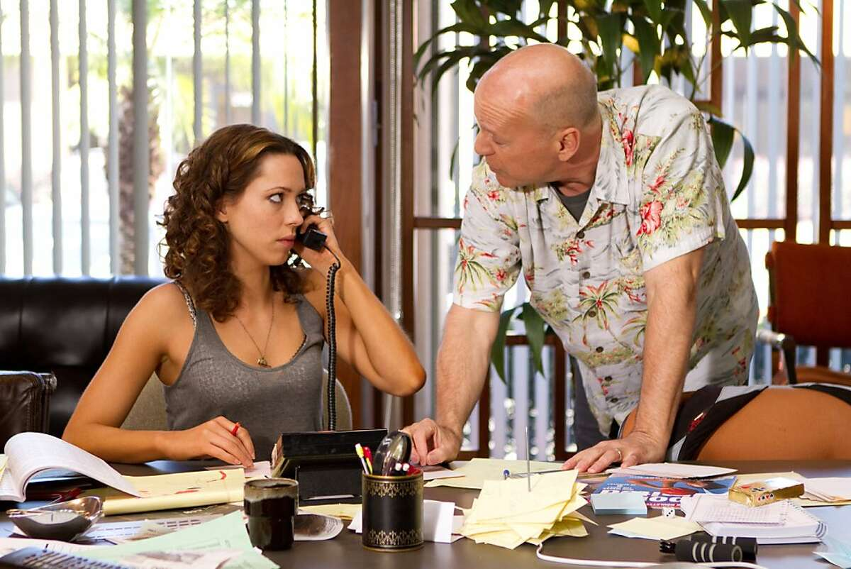 Rebecca Hall and Bruce Willis in LAY THE FAVORITE.