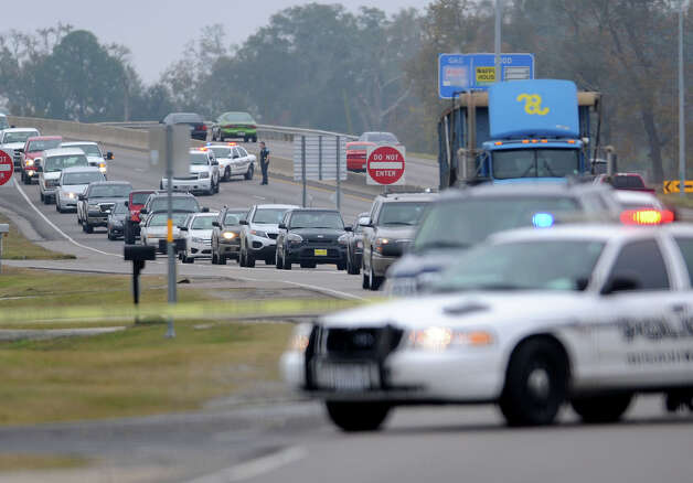 U.S. 69 traffic was backed up Thursday morning after a possible hit and run forced Beaumont Police to close the freeway and its feeder road. Cars were diverted through an adjoining neighborhood. Beaumont Police are investigating the event that occurred on U.S. 69 sometime before 6:30 Thursday morning. The incident occurred just north of the LNVA Canal. Photo taken Thursday, December 06, 2012 Guiseppe Barranco/The Enterprise Photo: Guiseppe Barranco, STAFF PHOTOGRAPHER / The Beaumont Enterprise