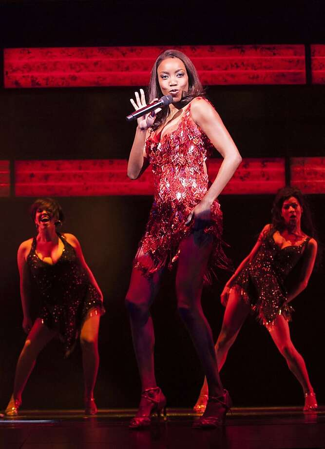 In this undated image made available Thursday Dec. 6, 2012, by the Adelphi Theatre, showing Heather Headley performing in the lead role in the new stage show musical The Bodyguard, directed by Thea Sharrock, not pictured, which is due to open at the Adelphi Theatre in London in December 5, 2012.  The stage show is based on the 1992 Bodyguard movie starring Whitney Houston in the lead role. (AP Photo / Paul Coltas, Adelphi Theatre) Photo: Paul Coltas, Associated Press