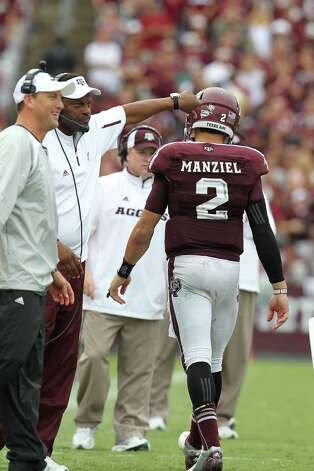 Texas A&M quarterback Johnny Manziel (2) celebrates his touchdown Aggies coach Kevin Sumlin in the fourth quarter at Kyle Field, Saturday, Sept. 29, 2012, in College Station. Texas A&M beat Arkansas 58-10. Photo: Karen Warren, Houston Chronicle / © 2012  Houston Chronicle