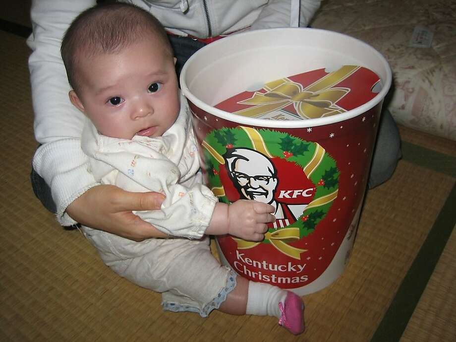 Japan: KFC for Christmas dinner   In many Japanese homes a KFC bucket with fried chicken is the main dish at Christmas. Thanks to a lack of turkeys and smart marketing by KFC the fried chicken  is so popular you have to order weeks in advance for the holidays. Ozchin/Flickr Photo: Ozchin (flickr)