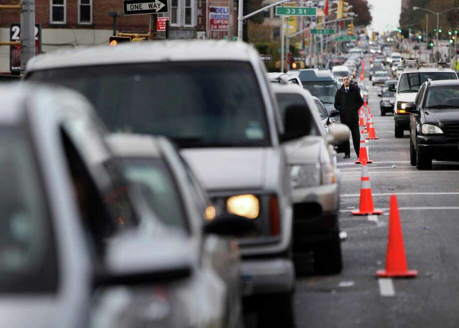 FILE- In this Nov. 2, 2012 file photo, cars wait in a 30 block long line for gas in the Brooklyn borough of New York. New York Mayor Michael Bloomberg and officials in the Long Island counties of Nassau and Suffolk have decided to start an even-odd gas rationing plan beginning at 5 a.m. Friday, Nov. 9, 2012.  (AP Photo/Seth Wenig, File) Photo: Seth Wenig