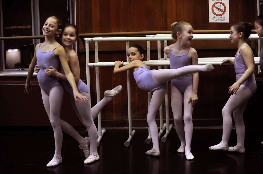 Dancers from left, Isabella Long, 8, Samantha Penn, 8, Caroline Volkwein, 8, Caroline Hendrickson, 8, Julia Barcello, 9, and Kotone Igarashi, 9, rehearsals for the Greenwich Ballet Academy's The Nutcracker, at the Greenwich Art/Senior, Greenwich Conn. Wednesday, Dec. 5, 2012. Photo: Helen Neafsey / Greenwich Time