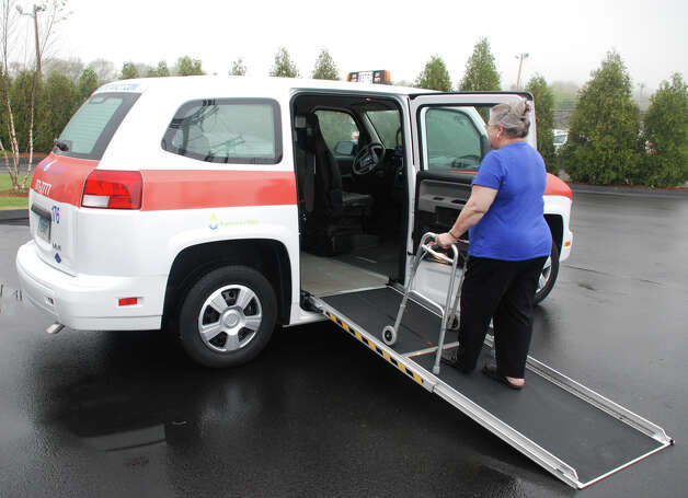 Diana LeBlanc of Thomaston gets into an accessible taxi at Metro Taxi, 65 Industry Drive, West Haven. Metro Taxi is partnering with the Trumbull-based Kennedy Center and other agencies to offer a pilot voucher program that will provide more convenient transportation to people with disabilities at a reduced price. Photo: Contributed Photo / Connecticut Post Contributed