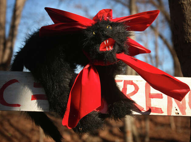 The SEIU 1199 union strikers' stuffed animal cat mascot wears a bow for the holidays at their camp outside West River Health Care Center on Orange Avenue in Milford on Thursday, December 6, 2012. This is the second straight holiday season that the workers have spent on the picket line. Photo: Brian A. Pounds / Connecticut Post