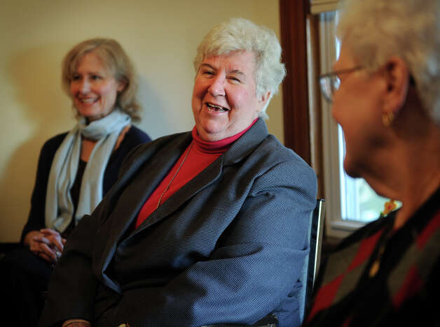 Nun Peg Regan smiles as she discusses her organization's mission of education and support for women at Caroline House in Bridgeport on Wednesday, December 5, 2012. Photo: Brian A. Pounds / Connecticut Post