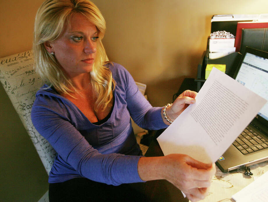 Amy Russell of Stratford holds an anonymous letter that she and her husband received concerning a home that they sold several years ago in a Raymark contaminated neighborhood. They were concerned enough with the letter to contact police. Photo: Brian A. Pounds / Connecticut Post