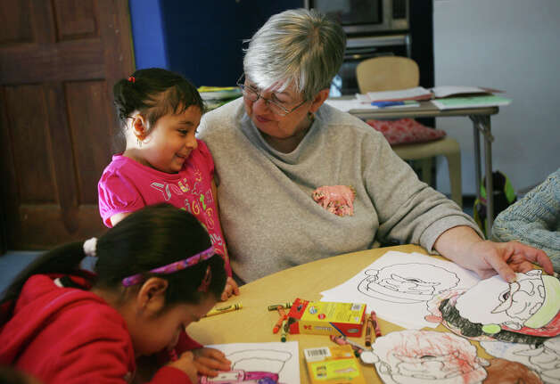 Preschool director Jean Fredricks does a craft project with her students at Caroline House in Bridgeport on Thursday, December 6, 2012. Photo: Brian A. Pounds / Connecticut Post