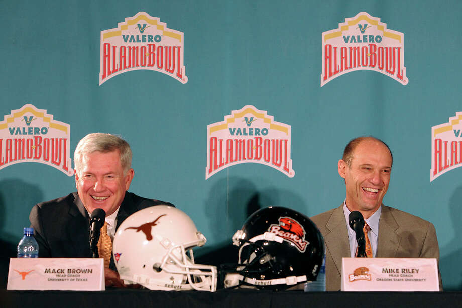 Texas coach Mack Brown (left) and Oregon State coach Mike Riley laugh during a press conference at the 2012 Valero Alamo Bowl presser at Sonterra Country Club on Thursday, Dec. 6, 2012. The game will be played at the Alamodome on Dec. 29th. Photo: Kin Man Hui, San Antonio Express-News / © 2012 San Antonio Express-News