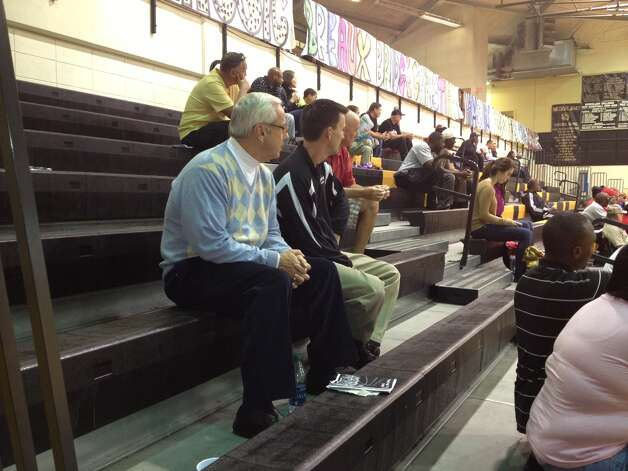 University of North Carolina men's basketball coach Roy Williams, left, sits next to Nederland boys basketball coach Brian English during a game at the Bulldog Classic in Nederland, Thursday, December 6, 2012. Photo: Courtesy Of Joshua Pillitere