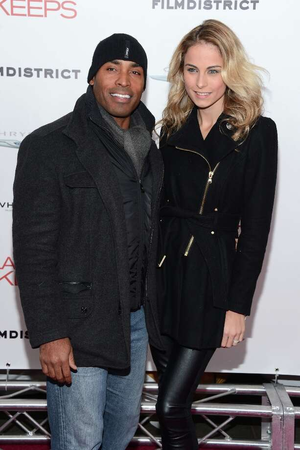 Tiki Barber and Traci Lynn Johnson attend FilmDistrict and Chrysler with the Cinema Society Premiere of Playing For Keeps at AMC Lincoln Square Theater on December 5, 2012 in New York City.  (Photo by Andrew H. Walker/Getty Images) Photo: Andrew H. Walker, Getty Images / 2012 Getty Images