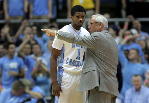 North Carolina head coach Roy Williams instructs point guard Dexter Strickland during the first half of an NCAA college basketball game against UAB in Chapel Hill, N.C., Saturday, Dec. 1, 2012.  UNC won 102-84.  (AP Photo/Ted Richardson) Photo: Ted Richardson, FRE / FR83921 AP
