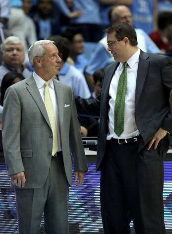 North Carolina head coach Roy Williams, left, greets UAB head coach Jerod Haase, a long-time assistant coach for Williams and former player at Kansas, after an NCAA college basketball game in Chapel Hill, N.C., Saturday, Dec. 1, 2012.  UNC won 102-84.  (AP Photo/Ted Richardson) Photo: Ted Richardson, FRE / FR83921 AP