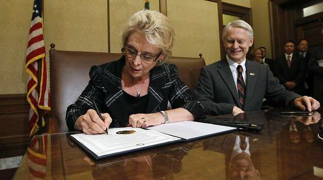 Washington Gov. Chris Gregoire signs the same-sex marriage measure. Photo: Elaine Thompson, Associated Press