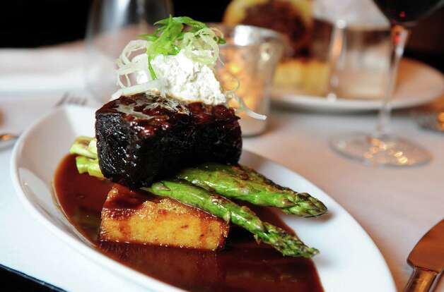 Braised Short Rib with a port glaze, crispy polenta, roasted asparagus and a horseradish cream at Aux Delices Bistro in Westport, Conn. Photo: Autumn Driscoll / Connecticut Post