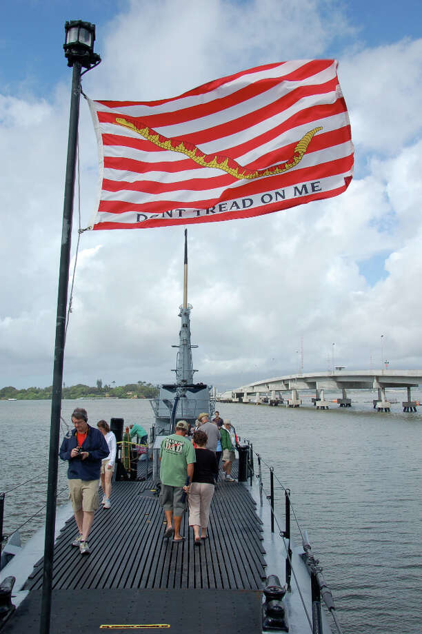The Don't Tread on Me jack, one of the earliest flags used by the U.S. Navy, flies above the USS Bowfin. (Jeanne Cooper / SFGate)