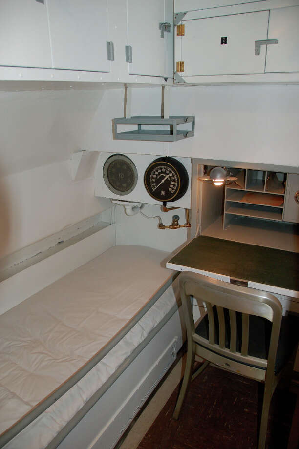 Sleeping quarters this roomy could only be for the Bowfin's captain, who used the indicators overhead to track the sub's depth and course. (Jeanne Cooper / SFGate)