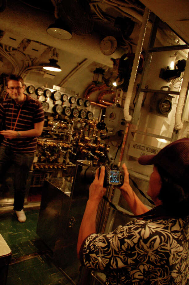 The sub's dizzying array of control valves and gauges makes a popular photo backdrop. (Jeanne Cooper / SFGate)