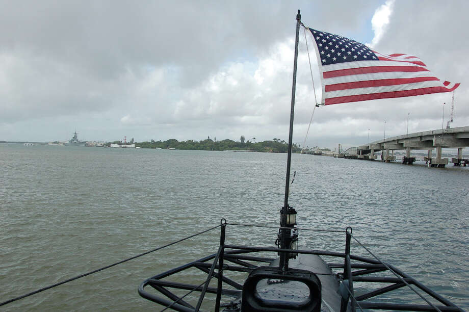 From the Bowfin's stern, the USS Arizona and  Missouri memorials -- symbols of the start and end of World War II in the Pacific -- can be seen in  the distance. (Jeanne Cooper / SFGate)
