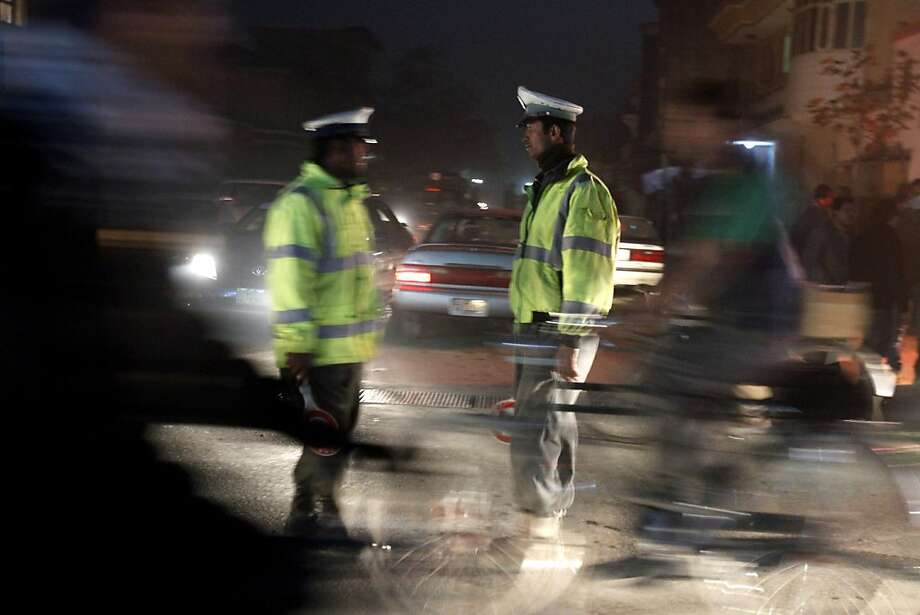 Police officers patrol the scene where Asadullah Khalid was attacked. Photo: Ahmad Jamshid, Associated Press
