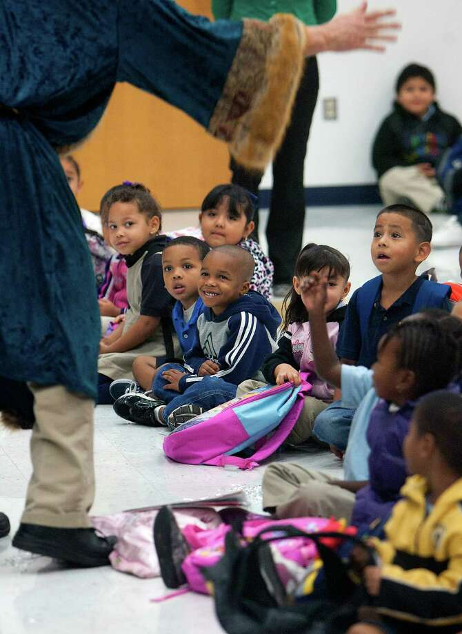Students react as Saint Nicholas visits students at Bruce Elementary School during St. Nicholas Day Thursday, Dec. 6, 2012, in Houston. Photo: Cody Duty, Houston Chronicle / © 2012 Houston Chronicle