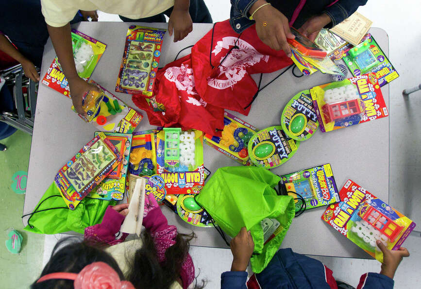 Kindergarteners open bags full of gifts from St. Nicholas at Bruce Elementary School during St. Nich