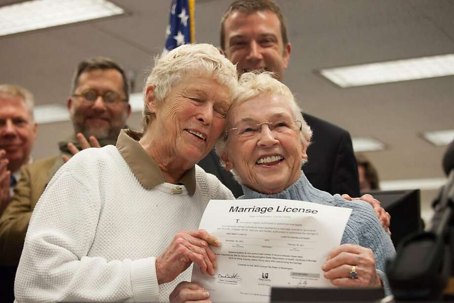 Jane Abbott Lighty (left) and Pete-e Petersen, who met on a blind date 35 years ago, are first in line for a marriage license at King County offices in Seattle. Photo: David Ryder, Getty Images