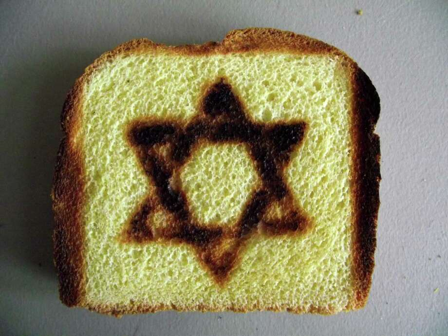 Your  toast  can be made with a specialty Star of David Toaster.  Photo: Associated Press / BurntImpressions.com
