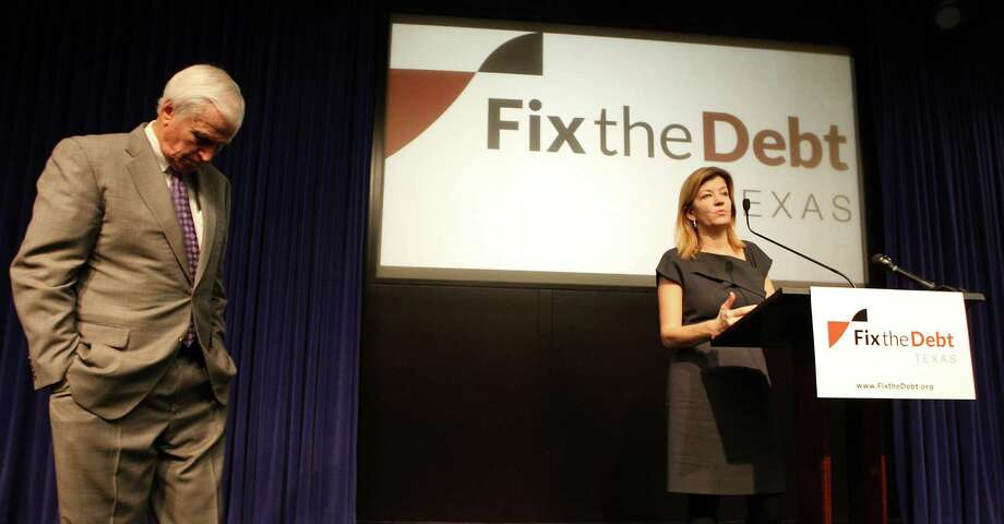 Maya MacGuineas, president of the Committee for a Responsible Federal Budget, speaks Thursday as former U.S. Rep. Charles Stenholm, a Texas Democrat, waits his turn during a Texas launch event for the Fix the Debt campaign. Photo: James Nielsen, Staff / © Houston Chronicle 2012