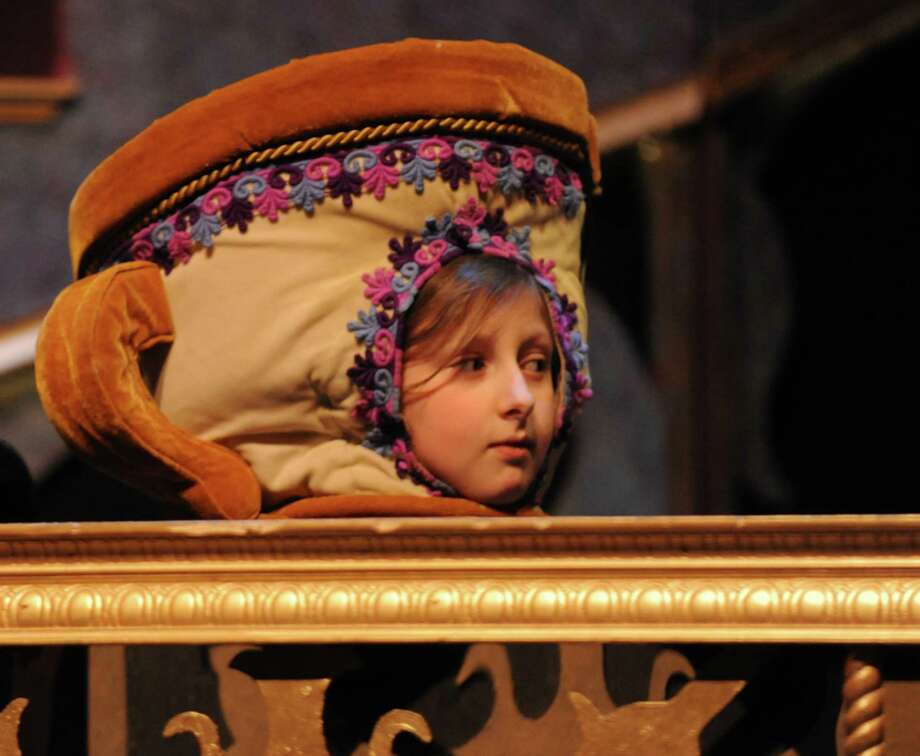 "Sarah Broder, a 5th grader at Bi-Cultural Day School plays the role of ""Chip"" in Stamford's All-School musical  ""Beauty and the Beast.""  The cast held a rehearsal on Thursday Dec. 6, 2012. Weekend performances are Dec. 7 & 8 at 7:30 pm and Dec. 9 at 3:00 pm at Rippowam Middle School, 381 High Ridge Rd. in Stamford, Conn. Photo: Cathy Zuraw / Stamford Advocate"