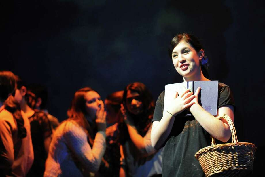 """Westhill High School junior Jessica Freedman as """"Belle"""" rehearses for  Stamford's All-School musical  """"Beauty and the Beast"""" on Thursday Dec. 6, 2012. Weekend performances are Dec. 7 & 8 at 7:30 pm and Dec. 9 at 3:00 pm at Rippowam Middle School, 381 High Ridge Rd. in Stamford, Conn. Photo: Cathy Zuraw / Stamford Advocate"""