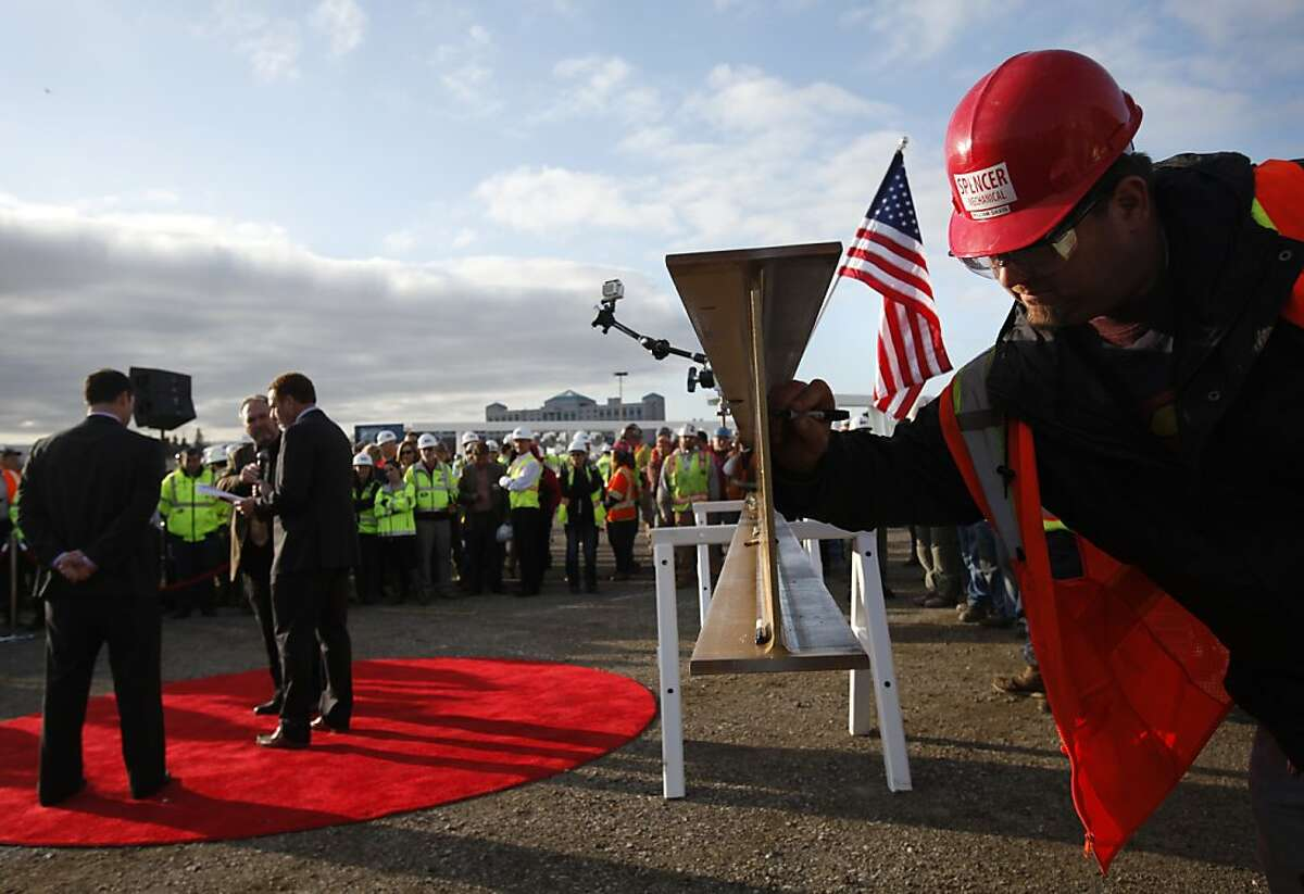 William Davis of Spencer Mechanical signs a steel beam before it is raised to the highest point of the new 49ers stadium in Santa Clara, Calif., Thursday, December 6, 2012.