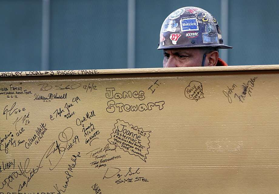 Mark Lorenzi of SME Steel signs the back of a steel beam before it is raised to the highest point of the new 49ers stadium in Santa Clara, Calif., Thursday, December 6, 2012. Photo: Sarah Rice, Special To The Chronicle