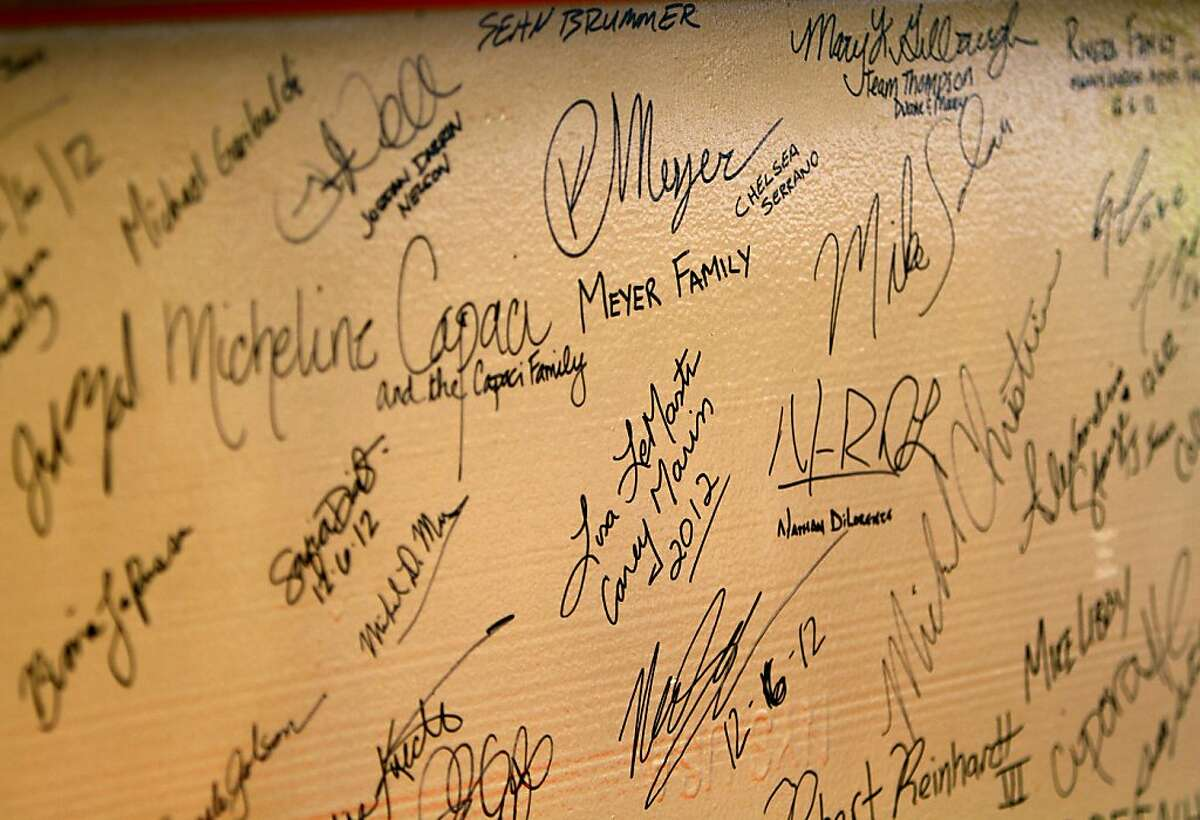 A signed I-beam waits covered in signatures to be added to the highest point of the new 49ers stadium in Santa Clara, Calif., Thursday, December 6, 2012.