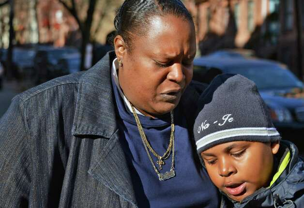 Aunt of stabbing victim Tonette Thomas, 20,Jessica Sprattley and he son Na'Ja Sprattley  outside the Wilborn Temple First Church in Albany Thursday Dec. 6, 2012.  (John Carl D'Annibale / Times Union) Photo: John Carl D'Annibale / 00020373A