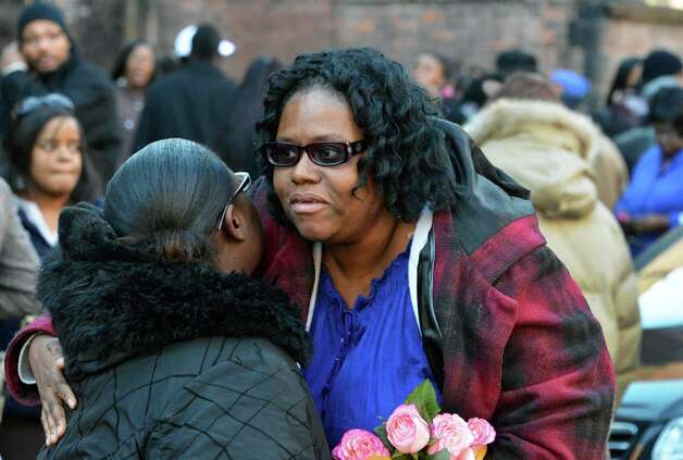 Mother of stabbing victim Tonette Thomas, Dorothy Carter, center, outside the Wilborn Temple First Church in Albany Thursday Dec. 6, 2012.  (John Carl D'Annibale / Times Union) Photo: John Carl D'Annibale / 00020373A