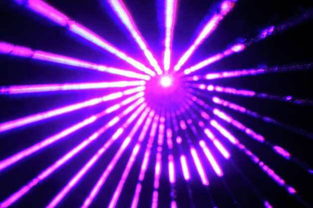 The Discovery Museum in Bridgeport will host 14 holiday laser shows each weekend through Dec. 23. Photo: Contributed Photo