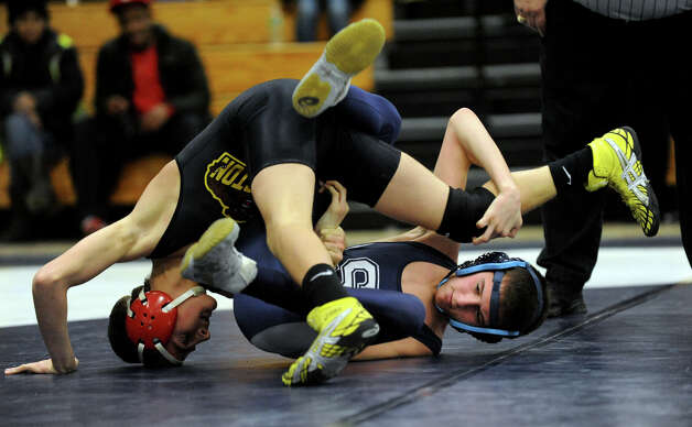Staples' Alex Kogstad, right, tries to get out from under Thomaston's Nejad Abo Hamzy, during wrestling meet action at Staples High in Westport, Conn. on Saturday January 22, 2011. Photo: Christian Abraham, ST / Connecticut Post