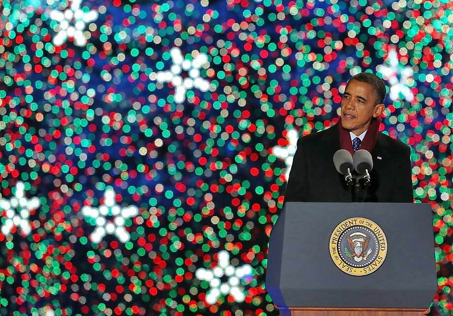 "President Obama speaks Friday after the lighting of the National Christmas tree. TV star Neil Patrick Harris hosted the ceremony, which included performances by singers Kenneth ""Babyface"" Edmonds, Ledisi, Jason Mraz, James Taylor and the Fray. The giant blue spruce is new and was transplanted in October on the Ellipse, a park between the White House and the National Mall. Photo: Mark Wilson, Getty Images"