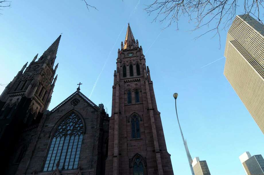 A view of the Cathedral of the Immaculate Conception on Thursday, Dec. 6, 2012 in Albany, NY.  The north steeple, on the right in the photo, contains the bells of the church, which will be played for the first time in many years.   (Paul Buckowski / Times Union) Photo: Paul Buckowski