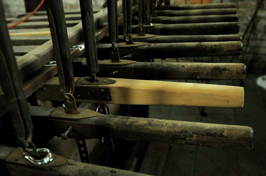A view of the wooden handles that are connected to rods that run up higher into the bell tower and connect to the bells in the north steeple of the Cathedral of the Immaculate Conception on Thursday, Dec. 6, 2012 in Albany, NY.   The bells will be played for the first time in many years.   (Paul Buckowski / Times Union) Photo: Paul Buckowski