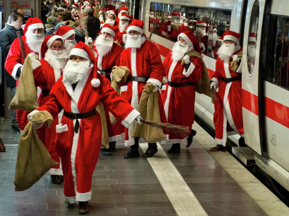 Around 400 Santas arrive by an ICE train at the main station in Frankfurt am Main, western Germany, on December 6, 2012. The action was initiated by Deutsche Bahn to surprise its passengers during Christmas. Photo: BORIS ROESSLER, AFP/Getty Images / DPA